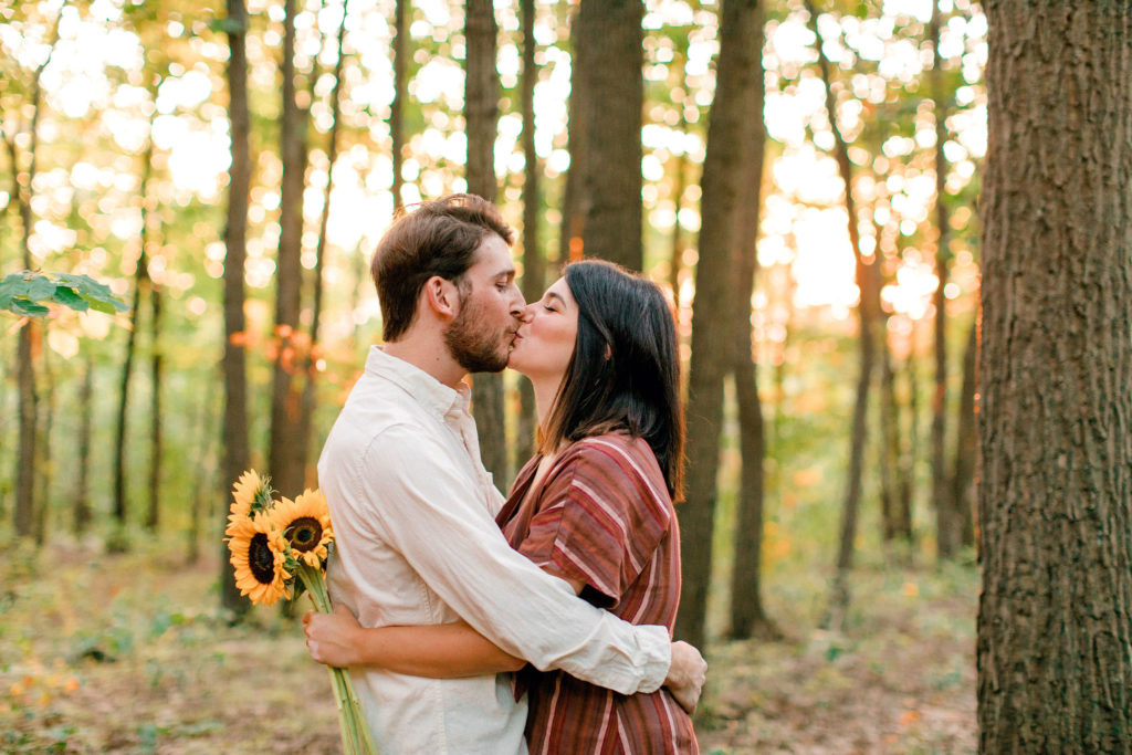 Couple with Sunflowers kissing at Bear's Den Overlook in Leesburg, VA