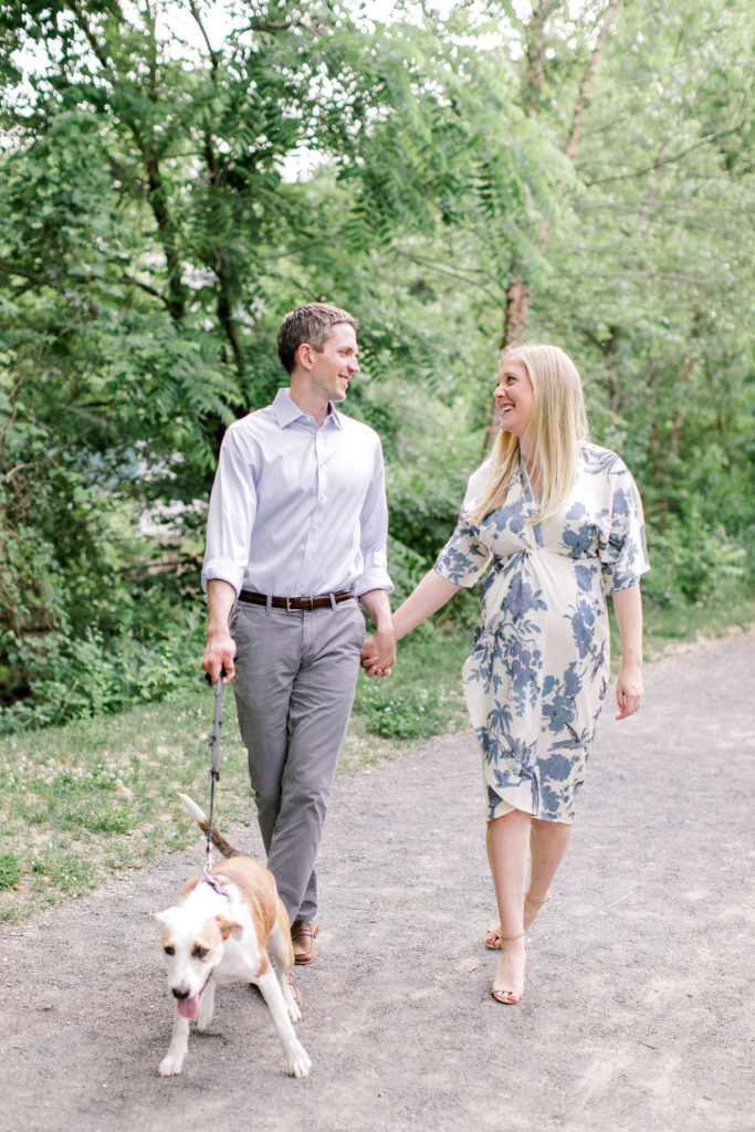 couple expecting baby with dog maternity photos