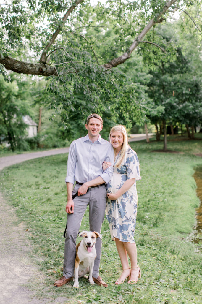 couple expecting baby with dog maternity photography