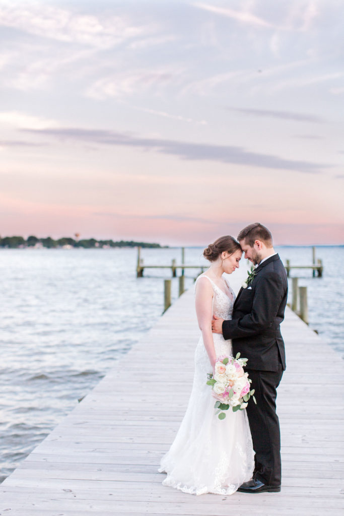 Couple at sunset with flowers from DC wedding florist